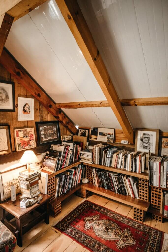 Small library in attic with lots of books