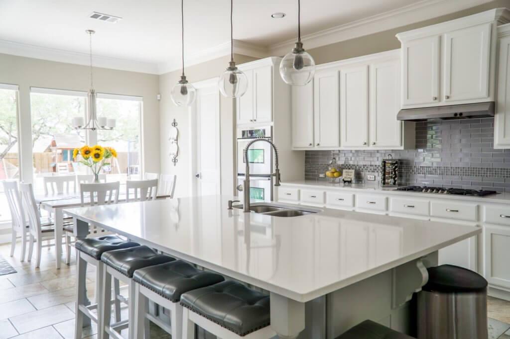 White kitchen with back garden view